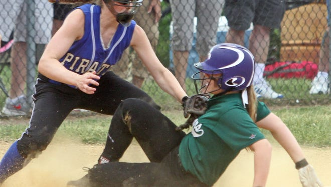 Pearl River third baseman Colleen McCoy wears a protective face guard while recording an out in the Section 1 Class A softball championship at North Rockland High School on May 30, 2015.