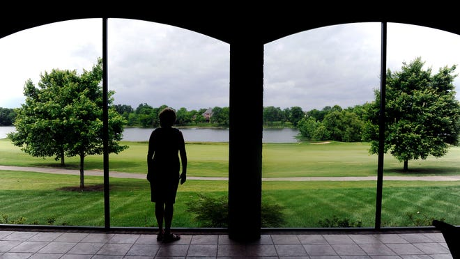 Marlene and Mike Kopczynski's Fairvue Plantation home looks out onto the golf course and Old Hickory Lake. They made a point of using golf-ball-proof screens on the patio.