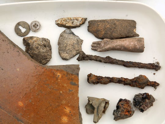 Artifacts from nails to buttons to the arm of a doll