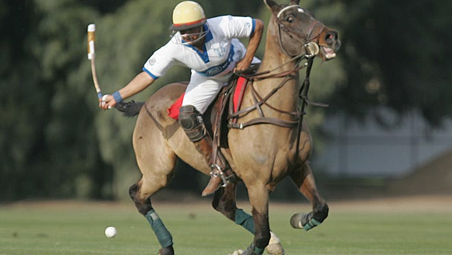 Manuel Rodriguez, with the Coldwell Banker Menlo in action against the Hacienda De Trampas, Thursday, January 6, 2011 at the Eldorado Polo Club in Indio.