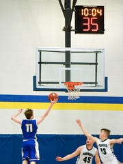 St. Cloud Cathedral's Nicholas Schaefer goes up for