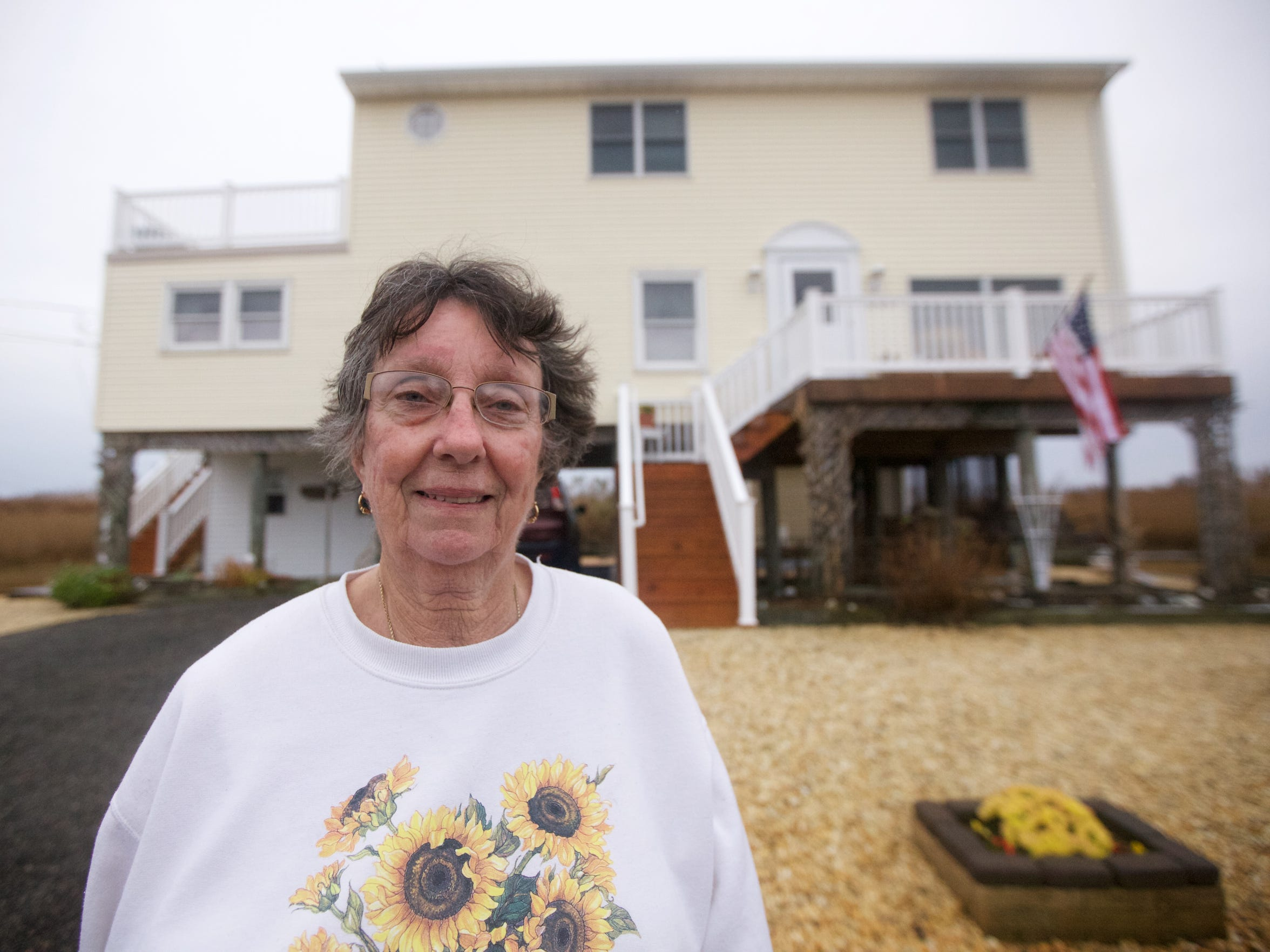 Maryann O'Neill is willing to tolerate the tides to stay in the home she loves.