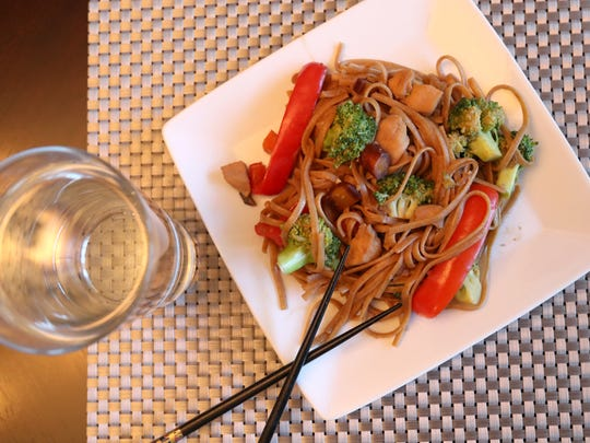 A sweet and spicy chicken vegetable stir fry on whole wheat linguini prepared by dietitian Anna Jones who says fruits, vegetables and whole grains are important nutrients for having a diet that helps to prevent cancer.