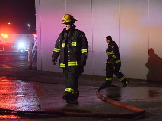 Officials investigate fire at office supply store