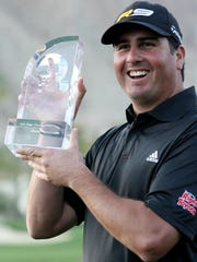Marilyn Chung/The Desert Sun Pat Perez holds up his trophy after winning the tournament on the final day of the 50th annual Bob Hope Chrysler Classic in 2009.