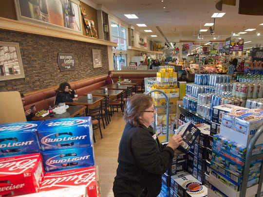 Fran Welsh, of York, stocks beer in the Beer Garden section of the Giant  supermarket on East Market Street in Springettsbury Township. Convenience, including the ability to buy beer in the same place they buy groceries, is something many shoppers want.