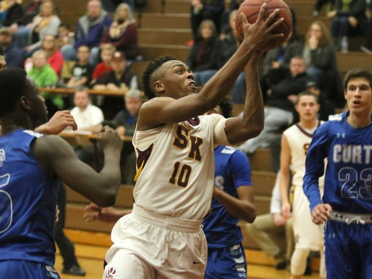 South Kitsap's Izaijha Byrd fights through the Curtis defense to score in the second quarter of a South Puget Sound League 4A game Tuesday night at South Kitsap.