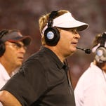 Predicting college football's top 25 teams for 2015