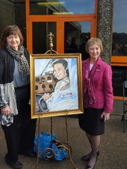 Linda Leffel and Susan Reid pose with the painting