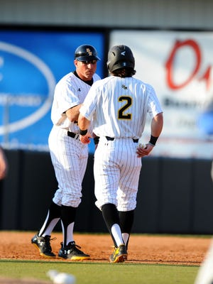Southern Miss head baseball coach Scott Berry, left, and the Golden Eagles host Northwestern State on Friday.