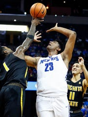 Memphis center Karim Sameh Azab (middle) battles Wichita