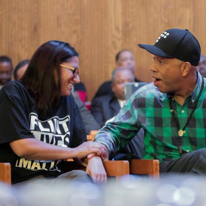 Russell Simmons reacts after noticing he's sitting