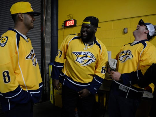 Tennessee Titans players Marcus Mariota, Quinton Spain and Ben Jones joke around prior to game 3 of the Western Conference finals at Bridgestone Arena Tuesday, May 16, 2017 in Nashville, Tenn.