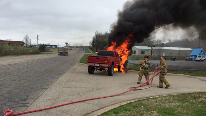 Mountain Home firefighters respond to the scene of a burning Chevrolet Z-71 pickup on U.S. 62 near the new Harps location Wednesday morning.
