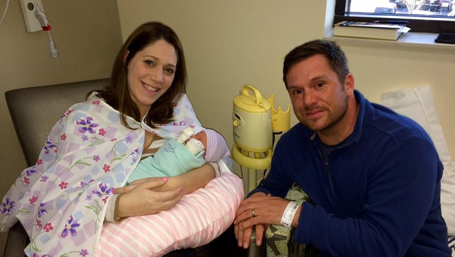 Jenna and Rodd Hunter, pictured with daughter Elenore at Hendersonville Medical Center's Birth Center for babies born prematurely.