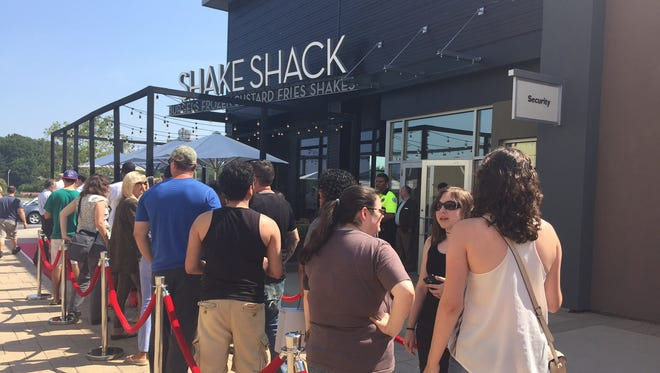 Customers lined up waiting for the opening of Shake Shack in Yonkers, July 22, 2016.