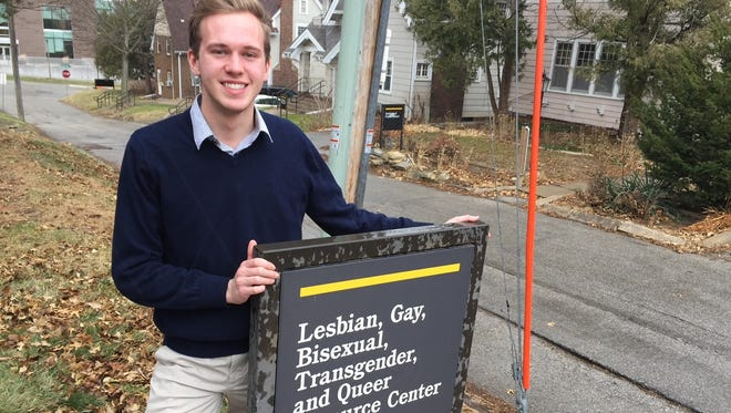 Alex Bare, outreach director for Spectrum, stands outside the University of Iowa's LGBTQ Resource Center on Grande Avenue.