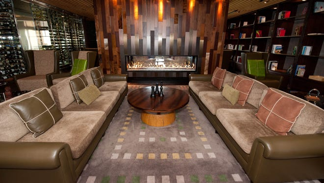 The Lobby Bar at the Viceroy Snowmass, Colorado: The two-sided fireplace is the highlight of this appealing lounge, which features local artwork and lots of wood accents. Comfort food with a southern twist is served, such as popcorn crawfish and okra.