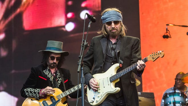 Heartbreakers lead guitarist Mike Campbell, left, and Tom Petty were in town Monday at US Bank Arena.