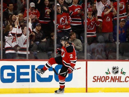 New Jersey Devils defenseman John Moore celebrates