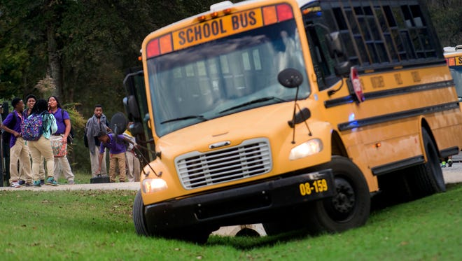 Students stand beside a Montgomery County school bus in a ditch along Wares Ferry Road on Thursday afternoon November 5, 2015.