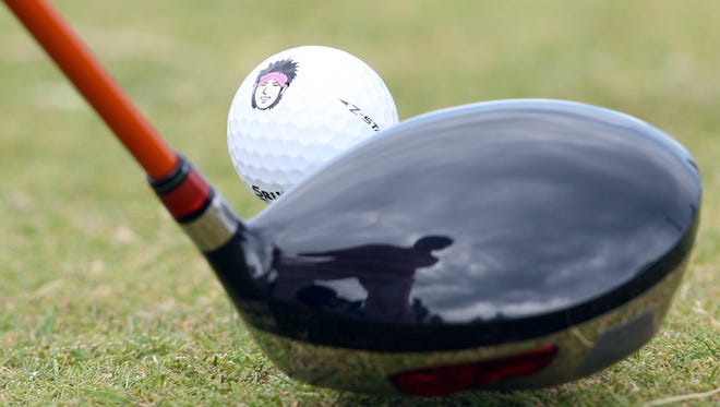 A caricature of Japanese golfer Ryo Ishikawa is seen on a ball as he addresses the ball on the sixth tee during a practice round at St Andrews in Scotland, on July 12, 2010 ahead of the 2010 Open Golf Championship which runs from July 15 to July 18.