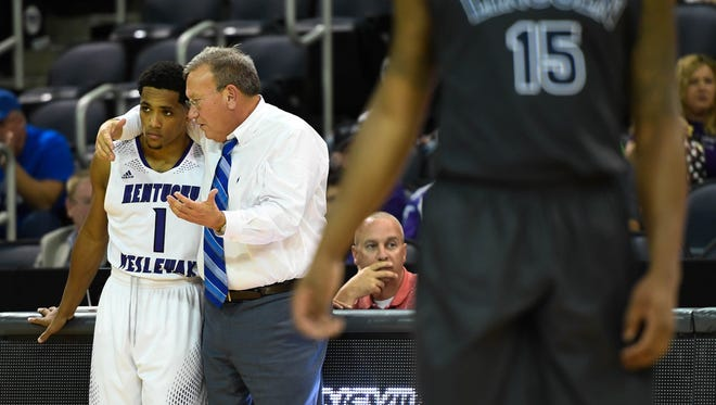 Kentucky Wesleyan head coach Happy Osborne talks with Shaakir Lindsey in the closing minutes as as Kentucky Wesleyan plays Lincoln Memorial in the second game of the Small College Basketball Hall of Fame Classic at the Evansville Ford Center Friday, November 18, 2016.