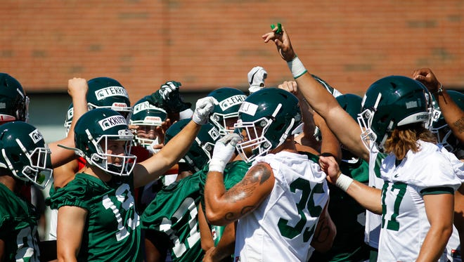Members of the Spartan football team rally Monday, July 31, 2017, during their first practice at the MSU football practice field.