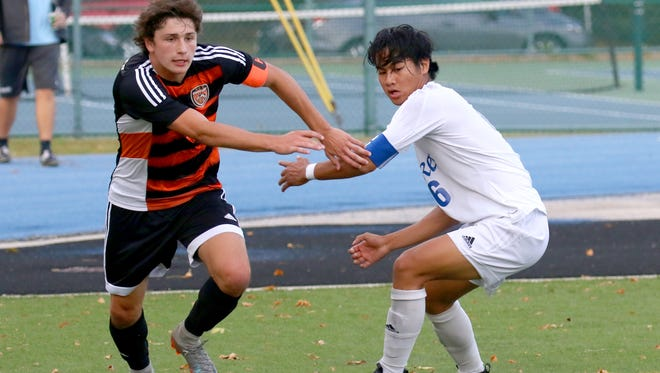 Cedarburg's Willy Kornetzke and Whitefish Bay's Shawn Azcueta battle for control of the ball at Whitefish Bay on Oct. 5.