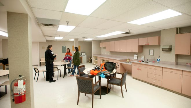 Living Room Project Executive Director Stephany Pond, center, and Centerstone Vice President of Adult Services Kim Brothers, right, chat with Louisville Metro Police Fourth Division Patrol Sergeant and Crisis Intervention Team Coordinator Pam Oberhausen in the newly opened facility. The trial program, funded in part through the city's 2017-2018 budget, offers those with serious behavioral issues a welcoming place where they can connect to professional services and treatment.   Dec. 10, 2017
