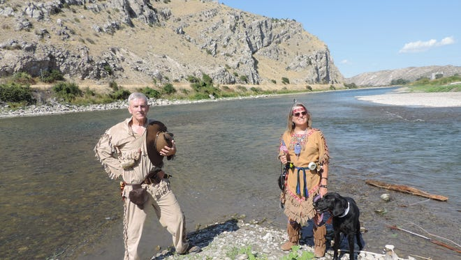 Dave and Carla Roberts, dressed as Capt. William Clark and Sacagawea, pose for a picture while traveling the same trail as Lewis & Clark