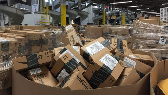 Piles of packages waiting for shipment at Amazon's Tracy, Calif. fulfillment center, one of  more than 50 such centers around the United States.