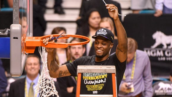 March 12, 2016; Las Vegas, NV, USA; Oregon Ducks forward Elgin Cook (23) celebrates after cutting down the net after the championship game of the Pac-12 Conference tournament against the Utah Utes at MGM Grand Garden Arena. The Ducks defeated the Utes 88-57. Mandatory Credit: Kyle Terada-USA TODAY Sports