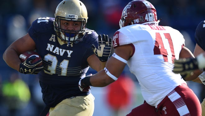 Navy Midshipmen fullback Shawn White (31) runs Temple Owls linebacker Jarred Alwan (41) defends during the second quarter  at Navy-Marine Corps Memorial Stadium. Mandatory Credit: Tommy Gilligan-USA TODAY Sports