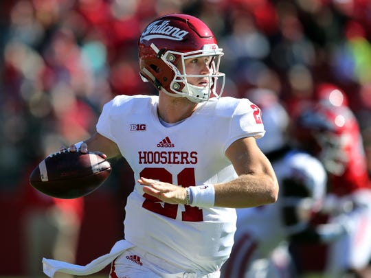 Indiana quarterback Richard Lagow (21) has provided a new look to the potent offense, particularly with his deep passing. But he can be rattled. How long will it take the Lions?