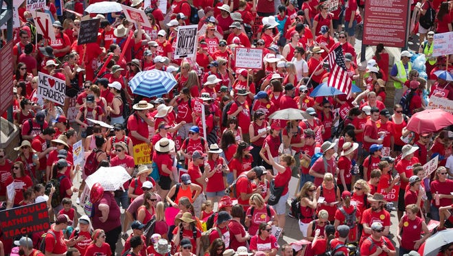 Teachers and supporters march to the state Capitol in Phoenix on April 26, 2018.