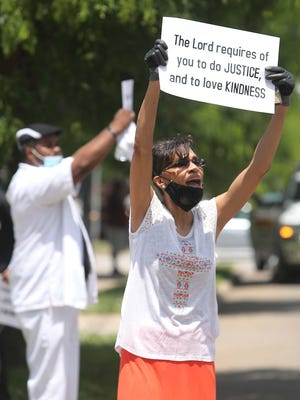 Carmen Bell of New Kingdom Apostolic Faith Church participates Saturday in the Stand for Justice Solidarity Rally at Zion Apostolic Faith Church in Akron.