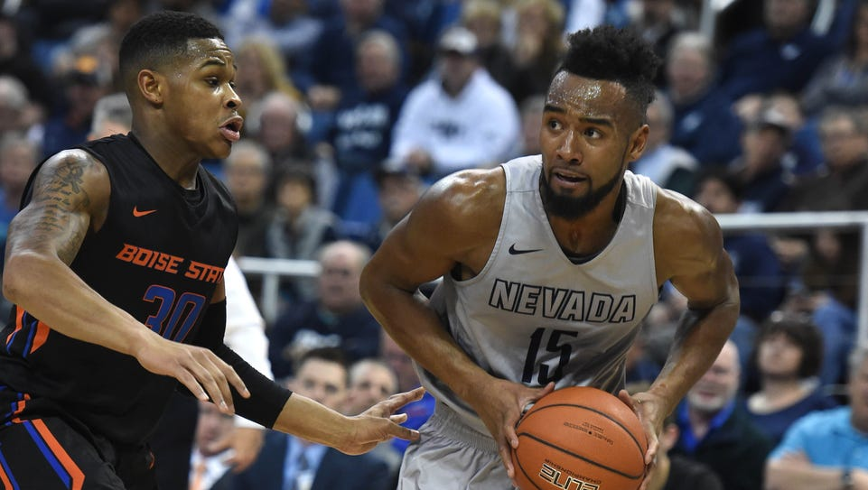 Nevada's D.J. Fenner looks to pass the ball while driving