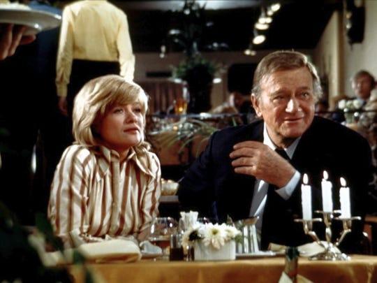 Judy Geeson and John Wayne in 'Brannigan.'