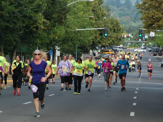 Participants make progress along the route during the High Street Hustle on Aug. 15, 2015 in Salem, Ore.