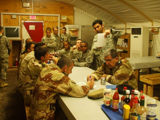 "Mohammed ""Pasha"" Berwari explains a U.S. Army mission"
