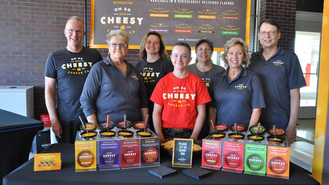 The team at Oh So Cheesy poses for a photo at the Holland Farmers Market. The booth will remain at the market until it closes for the season in December.