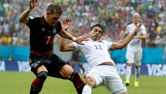 Germany's Bastian Schweinsteiger, left, is challenged by the United States' Alejandro Bedoya during a World Cup soccer match Thursday at the Arena Pernambuco in Recife, Brazil.