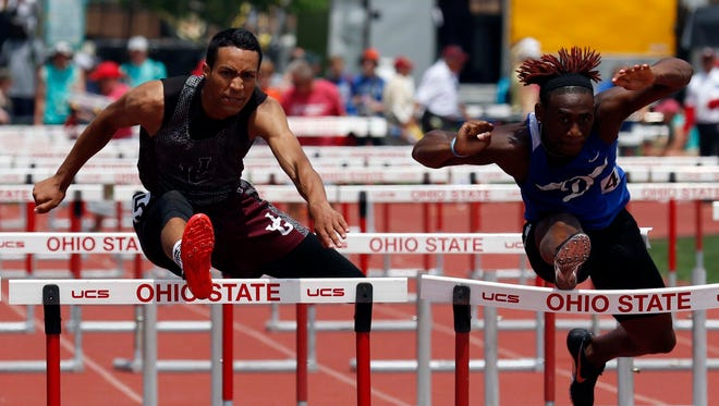 John Glenn's Joseph Clifford runs in the 110 hurdles Saturday, during the state track and field championship at Jesse Owens Memorial Stadium in Columbus. Clifford became a two-time state champion, winning that event as well as the 300 hurdles.