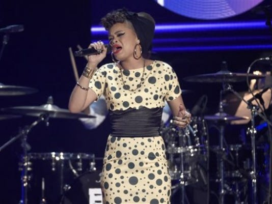 Andra Day performs at the BET Awards at the Microsoft Theater on  June 28, 2015, in Los Angeles. Retro dresses are all the rage this fall. Expect to see more polka dot dresses.  (Photo by Chris Pizzello/Invision/AP)