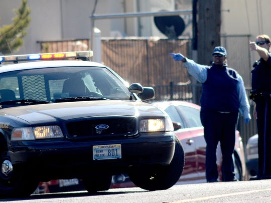 Reno police investigate a report of a shooting near the Park Silverada apartments and the Rita Cannan Elementary School on Friday. The shooting hospitalized one man and prompted a school lockdown.