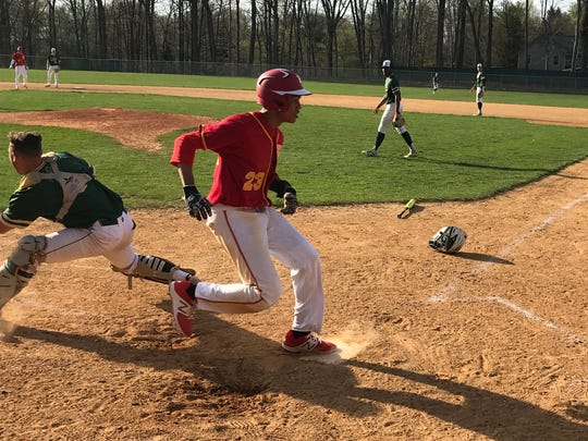 Amari Paula scores a run for Bergen Catholic in Wednesday's Big North United baseball game at St. Joseph.