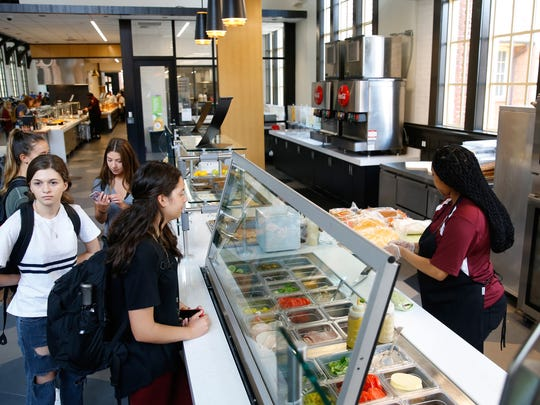 Students order from a new deli area of the Suwannee Dining Room at Florida State University. Customers are able to chose from pre-made sandwiches or can opt to build their own.