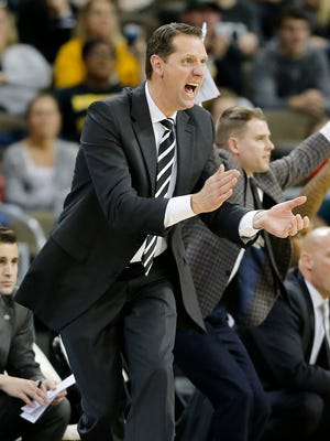 Northern Kentucky Norse head coach John Brannen shouts to his offense in the first half of the NCAA basketball game between the Northern Kentucky Norse and the Wright State Raiders at BB&T Arena in Highland Heights, Ky., on Thursday, Jan. 11, 2018.