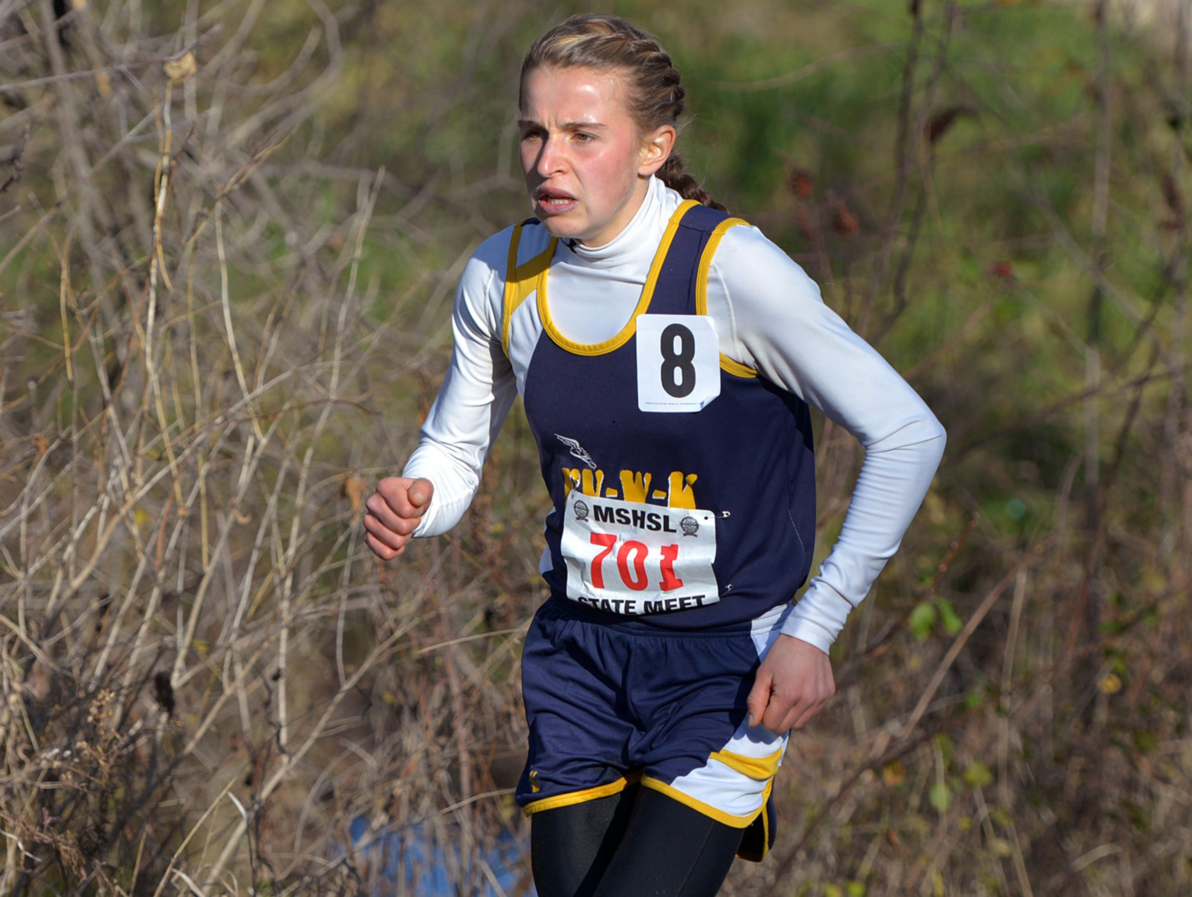 Eden Valley-Watkins/Kimball Area junior Anna Donnay paces herself up a hill during the girls' Class A state cross country championship race Saturday, Nov. 7 at St. Olaf College in Northfield. Donnay finished in 19:19.6 in seventh place.